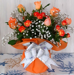 7 Orange Roses Wrapped with a bow tie