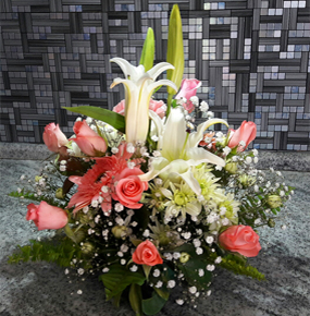 Bella Queen Posy with pink roses, pink gerberas and a white lily