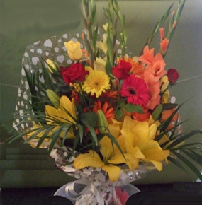 Wrapped Orange red & yellow mix with glaieul, lilies gerberas