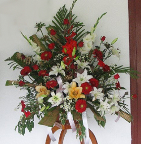 Red Gerberas and Roses with Lillies and glaieul